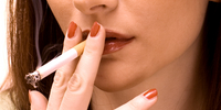 Woman smoking a cigarette thumbnail